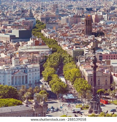Ramblas pedestrian street in the center of Barcelona. Landmark of Barcelona. Airview on the Rambla. - stock photo