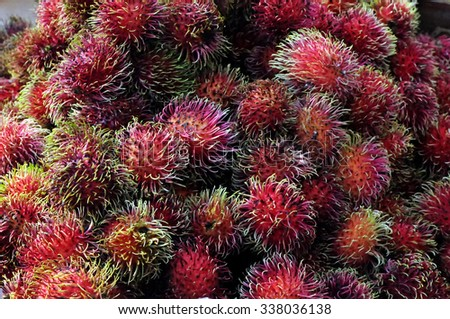 Rambutan, a tropical fruit, displayed at an outdoor market.