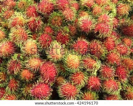 rambutan sweet delicious fruit.background of fresh Thai rambutans. rambutan pattern on wood background. - stock photo