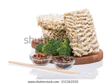Ramen instant raw noodles on wooden plank 3/4 presentation 1 general view - stock photo