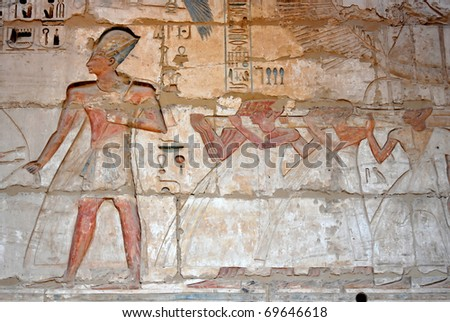 Rameses III leading a procession of priests carrying the sacred barque on a litter, Luxor in Egypt