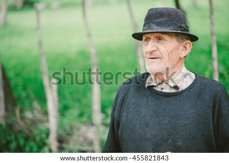 Ramet, Romania - APRIL 22, 2015: Unidentified man going home from work. Rural landscape and traditional village life in Romanian countryside.