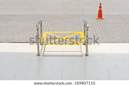 Ramp for disabled people using wheelchair of public building. - stock photo