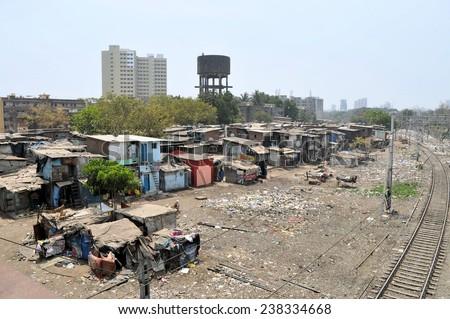 Ramshackle huts in Mumbai's slum Dharavi - stock photo