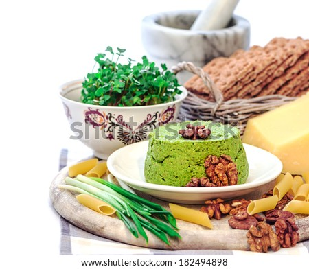 Ramson pesto with walnuts, radish sprouts and crisps - stock photo