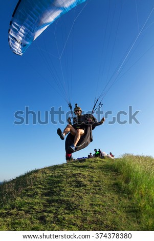 Rana - June 9: Aerial photos - paraglider prepare to flight  before the blue sky on June 9, 2014, Rana, Czech republic