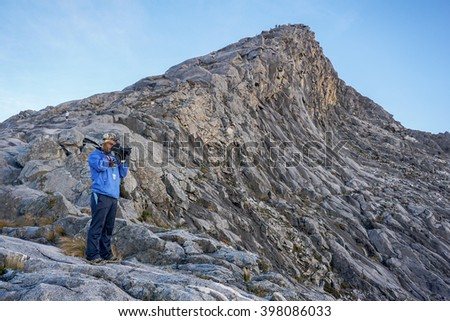 Ranau,Sabah,Malaysia-March 13,2016:Undentified of a photographer framing a shot, taking pictures beautiful view on summit Mountain Kinabalu,Ranau,Sabah.