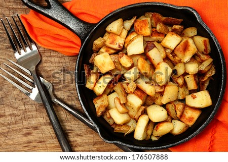 Ranch Potatoes or Home Fries in Cast Iron Serving Skillet - stock photo