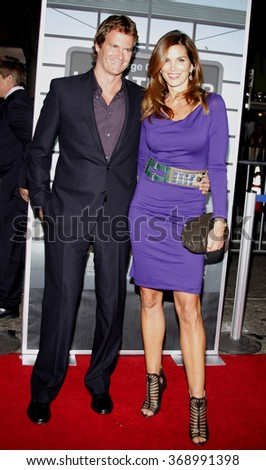 """Rande Gerber and Cindy Crawford at the Los Angeles Premiere of """"Up In The Air"""" held at the Mann Village Theater in Westwood, California, United States on November 30, 2009.  - stock photo"""