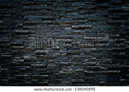 random black granite stone wall, grungy style - stock photo