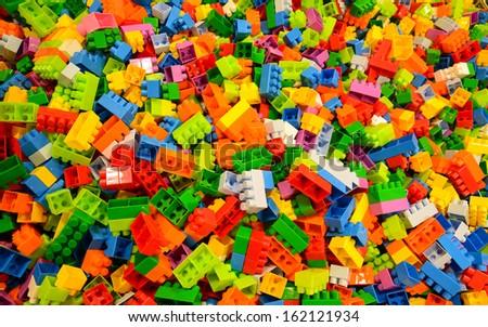 random coloured plastic construction blocks  - stock photo