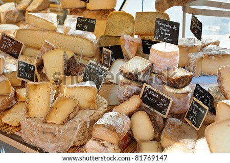 Random French cheese at rural Provence market, town of Aix-en-Provence - stock photo