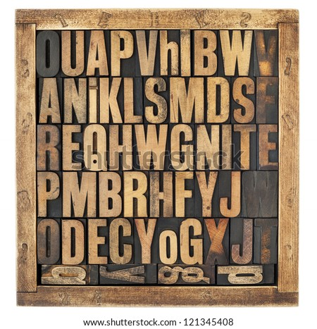 random letters of alphabet - vintage letterpress wood type blocks in rustic box isolated on white - stock photo
