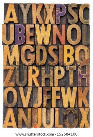 random letters of alphabet - vintage letterpress wood type printing blocks scratched and stained by color inks - stock photo