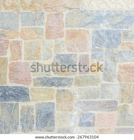 Random size and color slate stone wall - stock photo