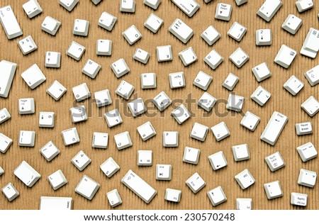 Randomly arranged computer keyboard keys  - stock photo