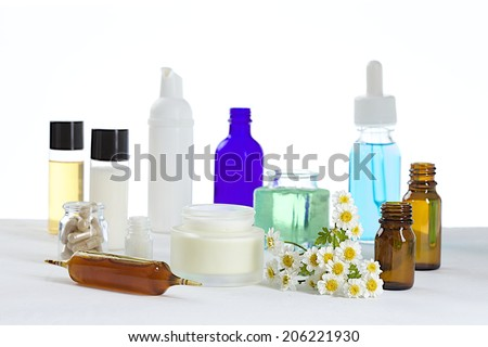 range of cosmetics and food supplements base on chamomile - stock photo