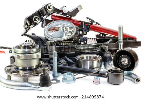range of spare parts for cars isolated on white background - stock photo