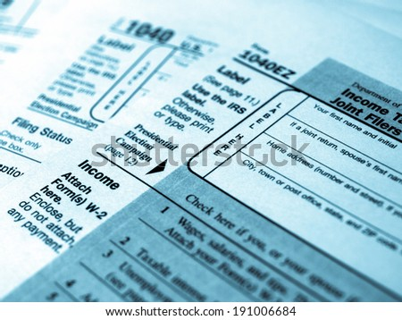 Range of various blank USA tax forms - cool cyanotype - stock photo