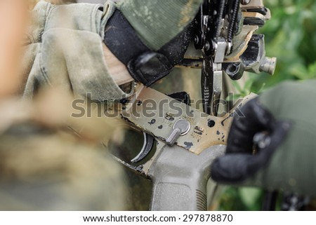 ranger repair fix the rifle with the tool in the battlefield - stock photo