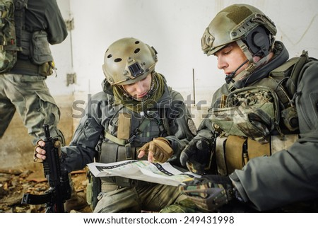rangers in the room looking at the map - stock photo