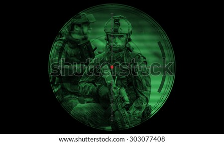 rangers team during night mission hostage rescue.view through the night vision scope - stock photo