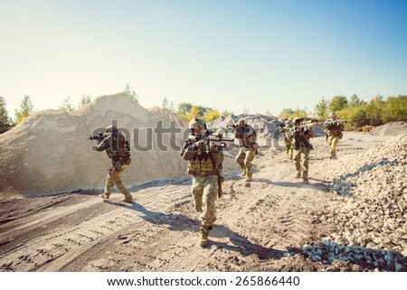 Rangers team is fighting on the territory occupied by the enemy - stock photo