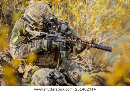 rangers  with a rifle aiming at a target - stock photo
