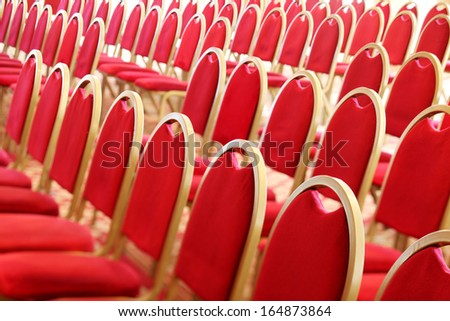 Ranges of empty red chairs. Closeup shot - stock photo