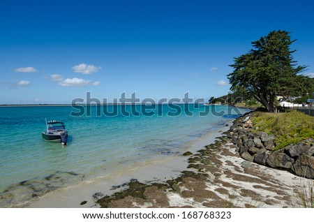 RANGIPUTA, NZ - DEC 20:Fishing bost in Rangaunu harbour, Rangiputa on Dec 20 2013.With an area of 115 square kilometres (44 sq mi) it is the fifth-largest harbour in New Zealand.