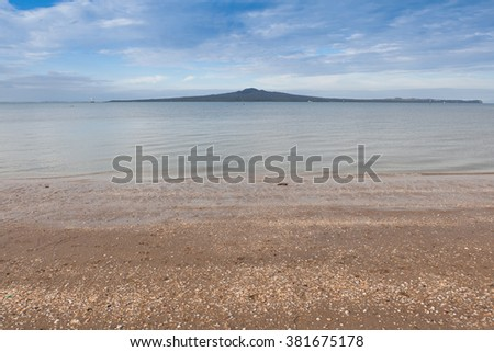 Rangitoto island from Mission bay view, Auckland, New Zealand. - stock photo
