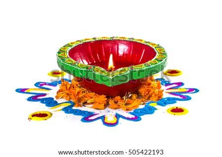 Rangoli single clay diya lamp lit stock photo royalty free rangoli and single clay diya lamp lit during diwali festival happy diwali greetings card design m4hsunfo