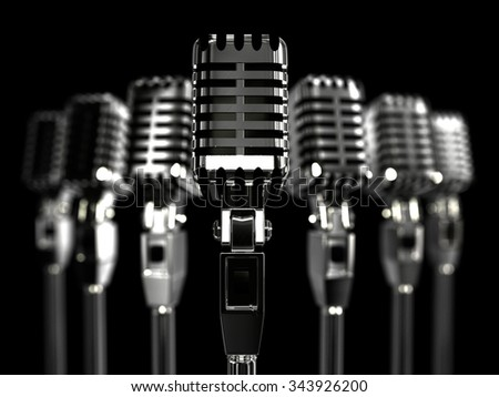 rank retro microphones with a shallow depth- Stock Image - stock photo