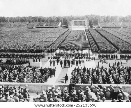 Ranks of the Nazi German army fill Zeppelin Field in Nuremberg. They are addressed by Hitler from a podium (center) during the Nazi Party Congress, Sept. 8, 1938. - stock photo