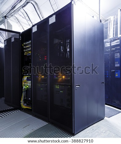 ranks supercomputers in server room - stock photo