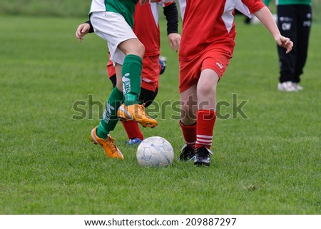 Ransta, Sweden - August 16: Young soccer player trying to take control of the ball, on August 16, 2008 in Ransta.