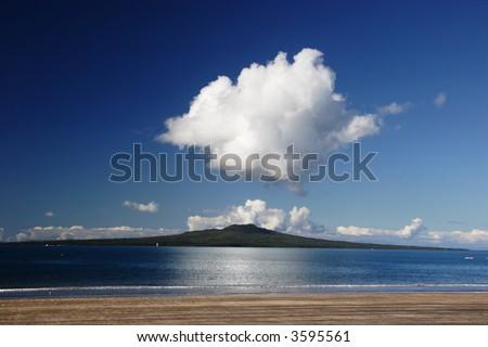 Rantitoto island from Takapuna Beach, Auckland, New Zealand - stock photo