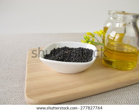 Rapeseed and canola oil - stock photo