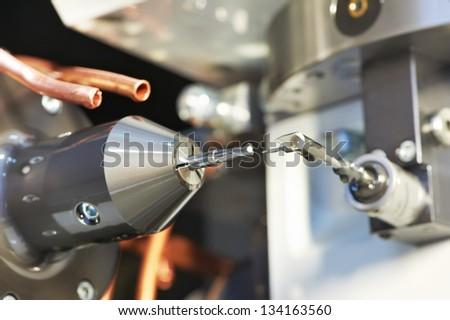 rapid machining steel drill for metalwork at machine tool measurement - stock photo