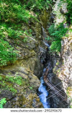 rapid mountain  brook flowing over rocks  - stock photo