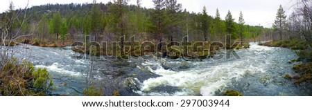 Rapid river in spring - stock photo
