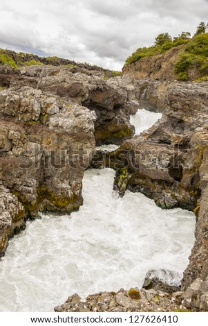 Rapid river near Hraunfossar waterfall - Iceland. - stock photo
