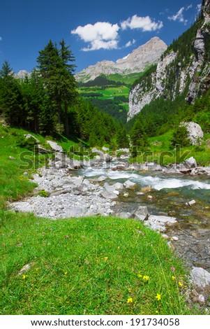 Rapid stream in Klausen Pass, Switzerland - stock photo