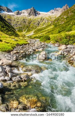Rapid stream in Swiss Alps, Mountain pass, Sustenpass - stock photo