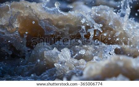 rapid stream of muddy river - stock photo