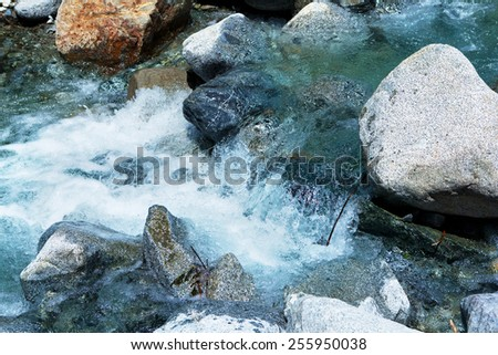 Rapid stream of rocky river or white water.  - stock photo