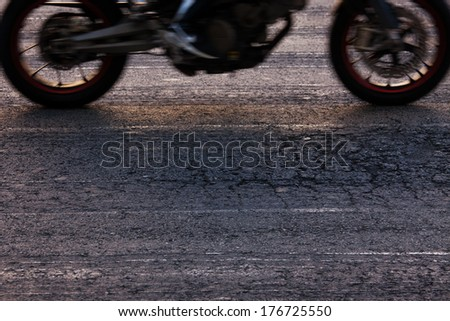 Rapidly traveling along the asphalt road bike - stock photo