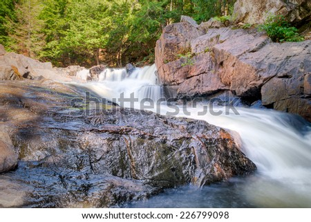 Rapids at the first drop at the Gut conservation area near Bancroft, Ontario, Canada - stock photo