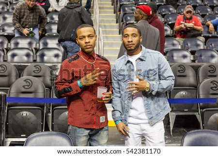 Rapper Bow Wow and friend Wackstar attends the game, Atlanta Hawks host the Oklahoma City Thunder at the Philips Arena on December 5th, 2016 in Atlanta Georgia - USA