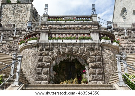 RAPPERSWIL, SWITZERLAND - MAY 10, 2016: Fountain in the form of the cave it is decoration of the stairway leading from the city square to the castle